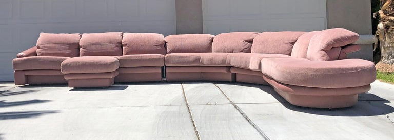 An absolutely stunning design by Vladimir Kagan for Preview, this millennial pink, or blush colored sectional is just as comfortable as it is easy on the eyes. Designed and manufactured in the 80's, the sofa is upholstered in both leather and a