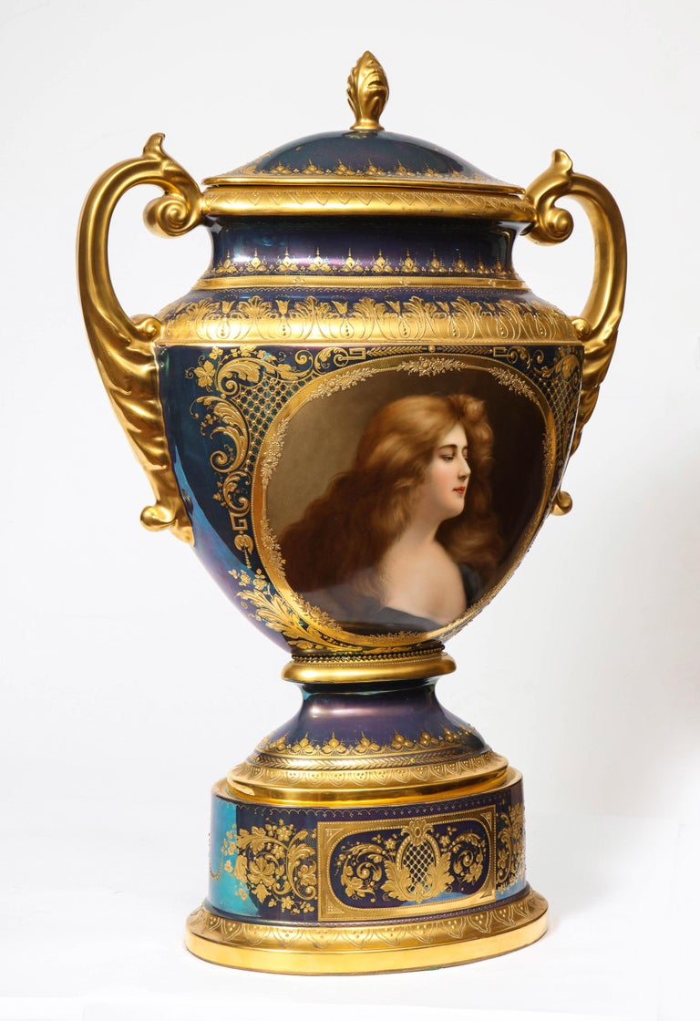 A monumental Royal Vienna Iridescent porcelain portrait vase and cover, Wagner, circa 1880.  This Royal Vienna Urn features an exceptional iridescent lustre, of flattened, 2 handled form, having an exquisite female allegorical hand-painted portrait