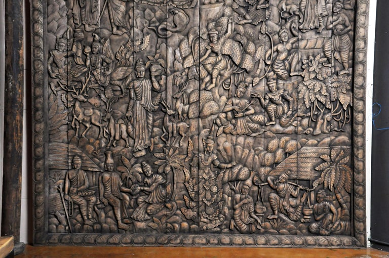 This newly hand carved wall panel features a relief design representing the life and story of Buddha. It includes the Thai angles (also known as deva, thep, thewa or thewada), titans and other mythical figures (Asuras, Pretas, Narakas), a stag
