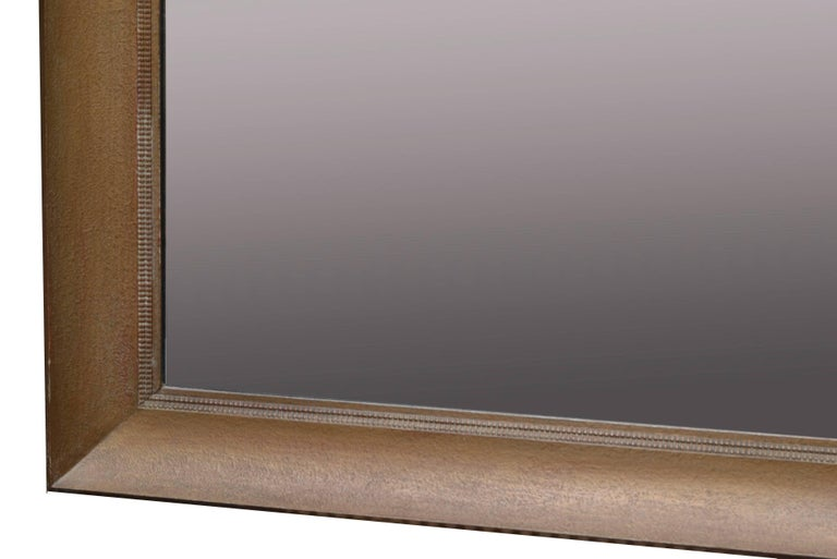 1950s large square wall or dresser mirror made by James Mont. The mirror has the original gold finish and shows some dotted texture. American craftsmanship in it's best. Can be used as single wall mirror or combined with a dresser.