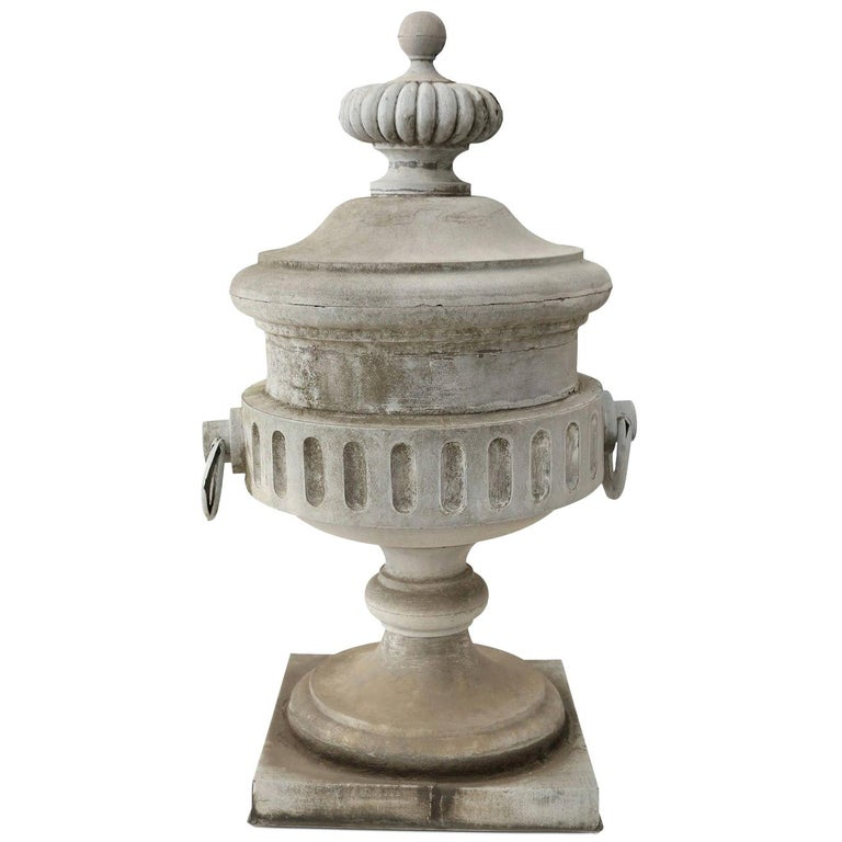 Monumental urn-shape zinc finial: extremely decorative architectural element from 19th century building.