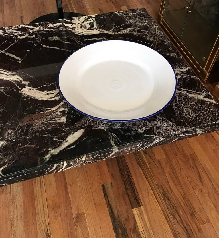 White ceramic large Italian faience charger. The handcrafted platter has a cobalt edge. Fantastic decorative object with fantastic proportions. Wonderful as a centrepiece or as a large serveware.