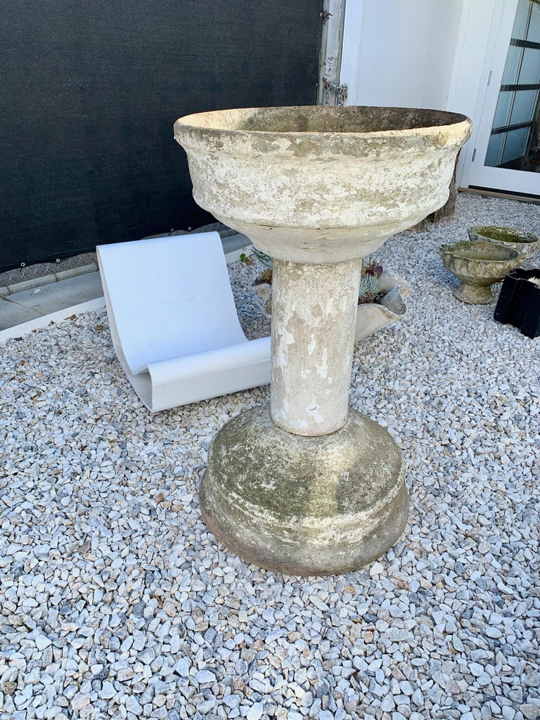 Massive and rare concrete fountain by Willy Guhl for Eternit. Fabricated out of three pieces of cement. Large basin on both ends with cylinder connecting the two. Great sculpture and object. Bowl has factory drilled holes to allow water to pass