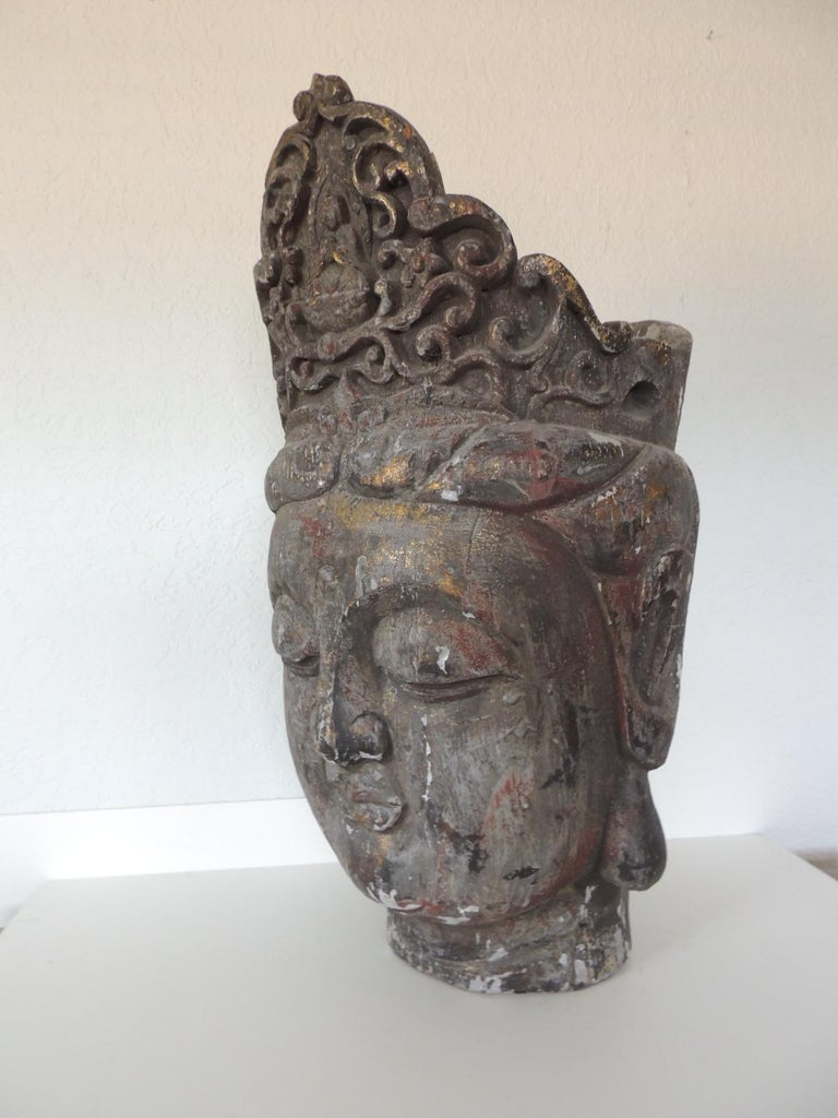 Monumental wood Buddha head statue from Thailand.