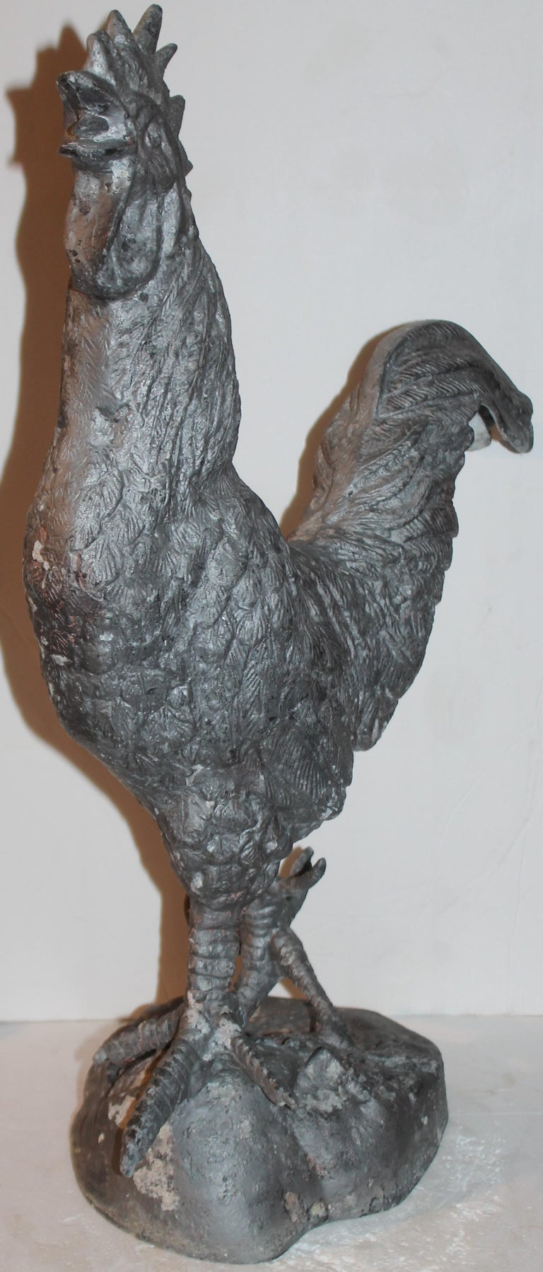 This fantastic zinc rooster looks like its from a garden or a farm. Fantastic porch or window ornament. Great country look.