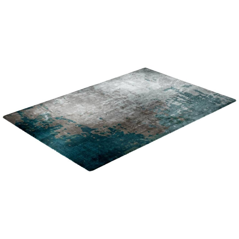 Moody Blues rug created by Cristina Jorge de Carvalho from the Fortuny collection. A collection Inspired on the historical walls of Venezian Fortuny Palazzo, capturing the color deterioration over time.  Produced entirely in Portugal by the best