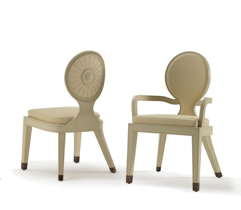 Moon and sun dining armchair in shiny mahogany finish Dining armchair frontal and outside back covered with leather col. cream seat upholstered with leather col. cream and bronzed brass tips.  Dimensions: 53 W x 53 D x 90 H, SH 46 cm.  This item has