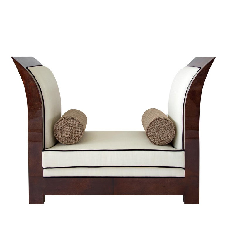 Sculptural and sophisticated, this stunning bench features a rectangular silhouette with tall, curved sides finished with parchment in a matte mocha color (col. 106). The seat cushion and sides (both internal and external) are upholstered in ivory