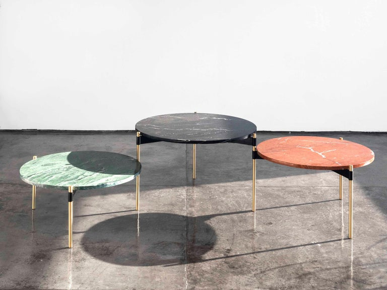 Moon is a single coffee table conformed by three round tops, which by rotating on the axis of the leg they share with its adjacent top, allows different configurations to be formed.  This version of the table features different marble top types,