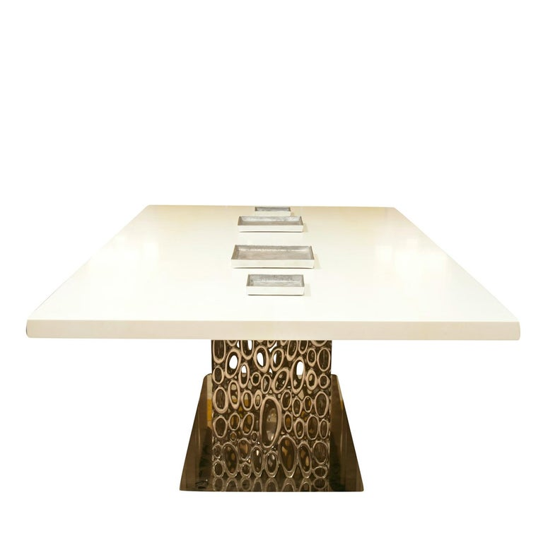 Whether in a contemporary office interior or in a modern dining room, this stunning table will elevate any environment with its captivating silhouette. The smooth, rectangular top is finished with matte natural parchment (col. 102) and is supported