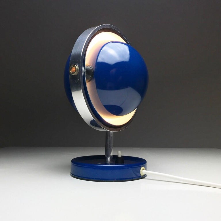 Extremely rare piece of design from the space age era: a unique table or wall lamp 'Moon Light' designed by the design duo Flemming Brylle and Preben Jakobsen also known as Quality System.   The composition of this beauty sums up the space age
