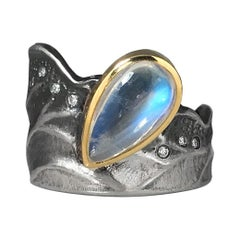 2.4 Carat Rainbow Moonstone and Diamonds Ring made from 18 Karat Gold and Silver