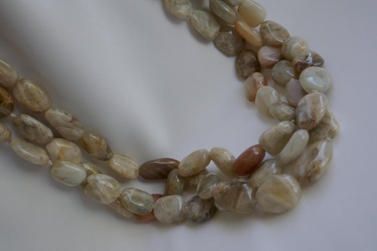 Love moonstones!!! This a stunning statement necklace. This three strand nugget moonstone necklace has beautiful stones the nuggets are in a pale peach, off white and beige tones.The tones of this moonstone necklace are beautiful. The size of the