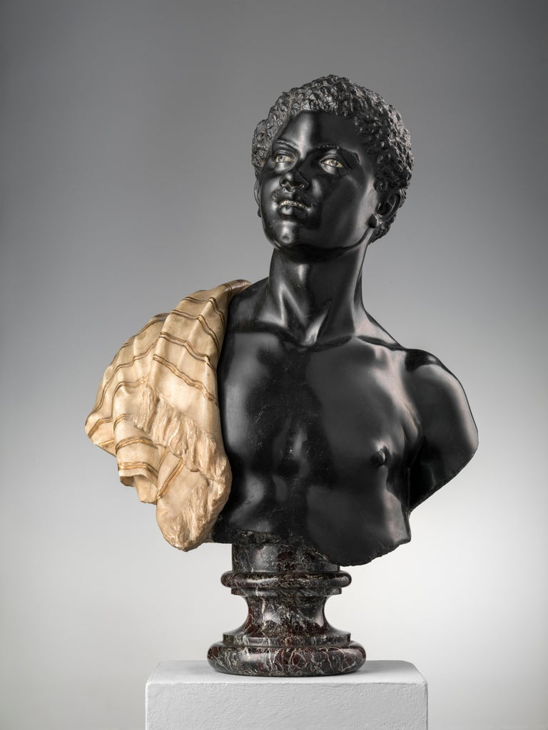 Moor marble bust in a Belgium black marble, the drape in painted white marble.