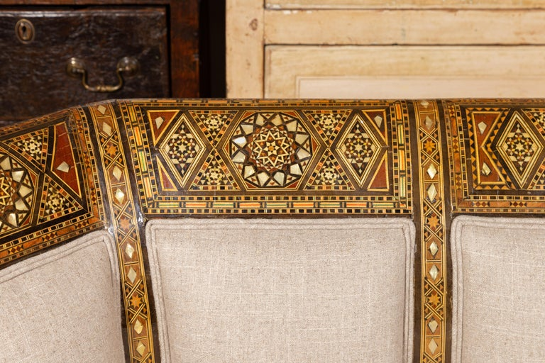 Moorish Style 1920s Settee with Inlaid Geometric Décor and Out-Scrolling Back In Good Condition For Sale In Atlanta, GA