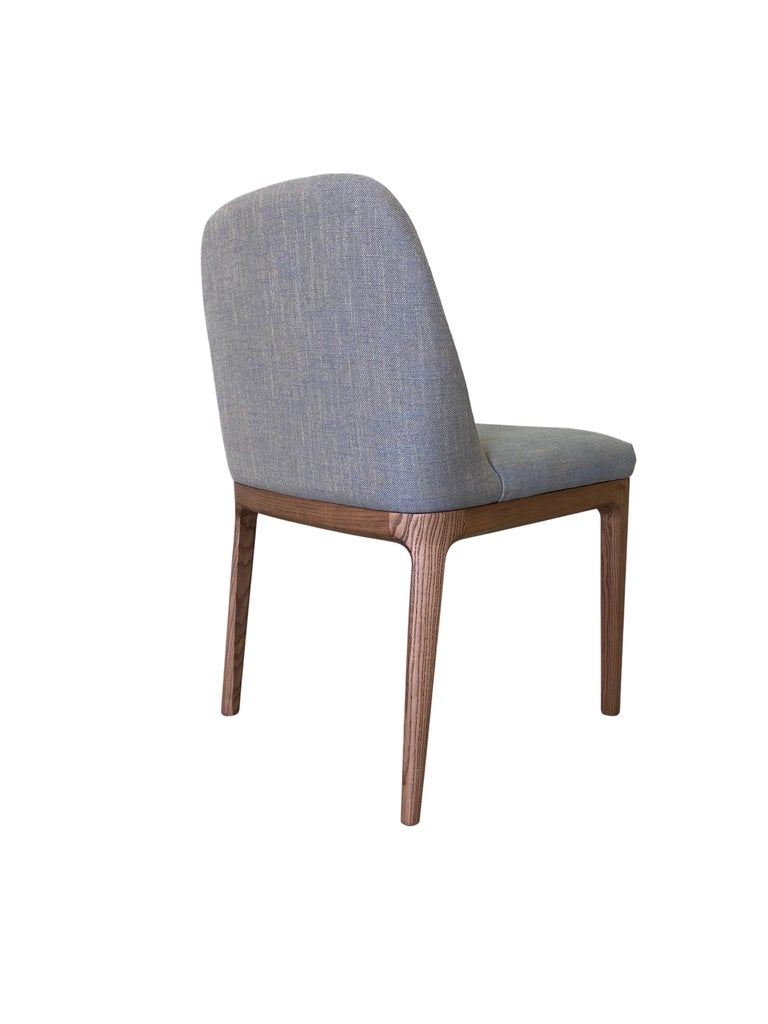 Contemporary style Bellagio dining chair made of ashwood with leather or fabrics upholstered seat. Design Libero Rutilo.