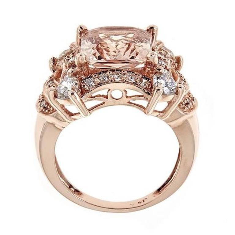 5.0 Carat Morganite and Diamond 14 Karat Solid Gold Cocktail Ring Size 7  Modern and elegant style. Crafted in gorgeous 14k Rose Gold, this ring features 5 TCw of princess cut morganite set in a four-prong setting. Accented by 4 small round diamonds