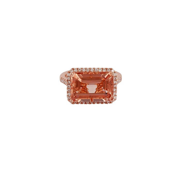 This is an elegant ring of morganite & diamond studded in 18k rose gold features an octagon-shaped morganite weight 6.57 carats & 48 pieces of round shaped diamonds weight 0.50 carats this entire ring is made of 18k rose gold weight 4.46 grams, this