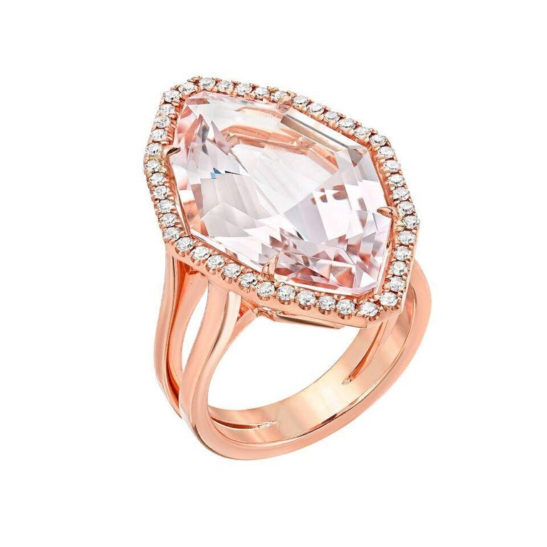 10.69 Carat superior cut Morganite and 0.15 Carats total, diamond ring. Hand crafted in 18K rose gold. Size 6. Resizing is complementary upon request. ***Returns are accepted within 7 days of delivery and will gladly be paid by us. Rings resized
