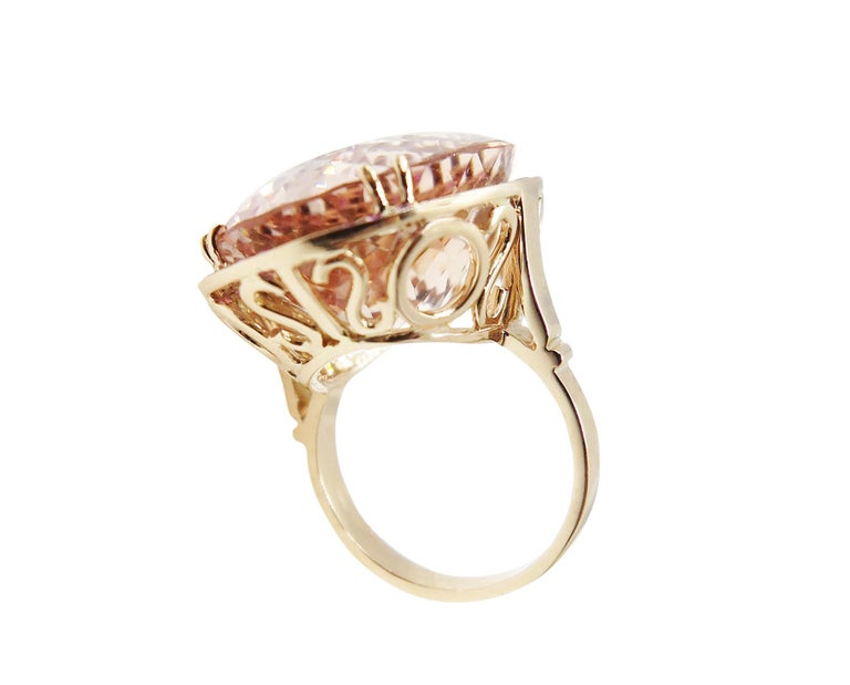 This stunning piece features 33 carat Oval Morganite set with pink sapphires and diamonds in 18 Karat rose gold. Pink Sapphires 0.61 carat, Diamonds 0.09 carat.