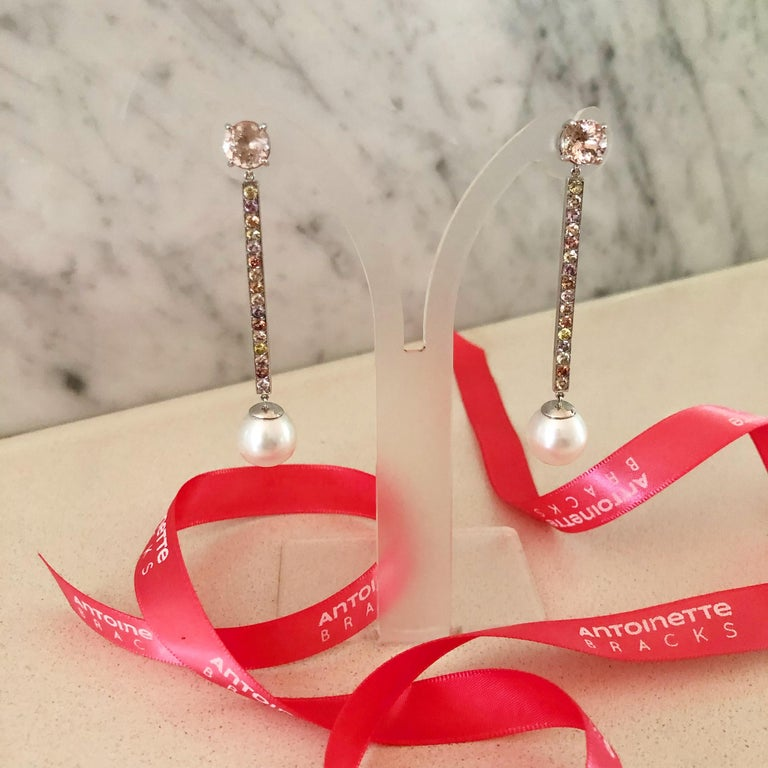 These stunning one-off, Morganite, Sapphire, Freshwater Pearl and 18 carat White Gold Handmade Drop Earrings were designed for the red carpet and worn at Australia's 2019 TV Week Logie Awards. They feature two, claw set brilliant cut morganites