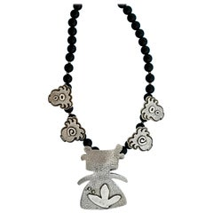 Morning Walker with Plants necklace, Melanie Yazzie cast sterling silver onyx