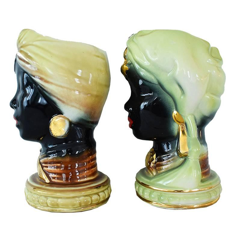 Gorgeous pair of moro genie planters or vases. No chips or scratches, and in perfect condition. Features yellow and green details with gold. Would be lovely with a few potted succulents or even a fresh small bouquet of flowers.
