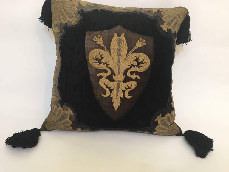 Moroccan black silk decorative accent pillow with large black tassels on each corner. Baroque Moorish Black silk velvet decor applique and embroidered in front of the pillow. Zipper in the back side.