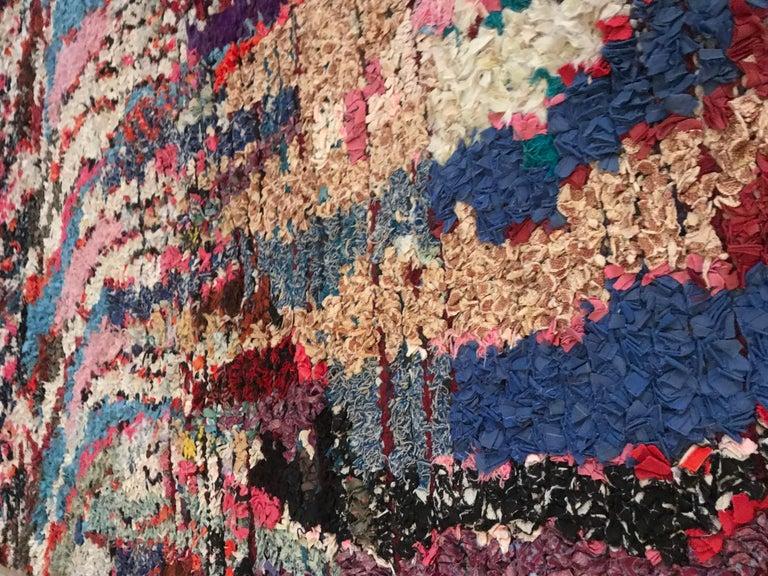 Beautiful Boucherouite rag rug in a multicolored pattern.