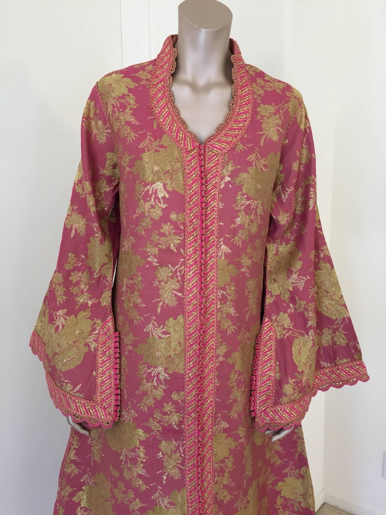 Elegant vintage designer Moroccan kaftan, embroidered with pink and gold trim.