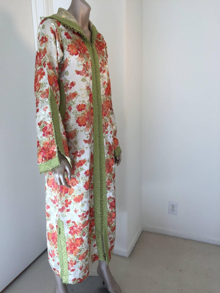 Elegant vintage designer Moroccan kaftan, hooded caftan white with red and gold flowers and embroidered with green woven braided buttons and loops. This chic Gypsy Bohemian multi-color maxi dress hooded kaftan is embellished with green woven buttons