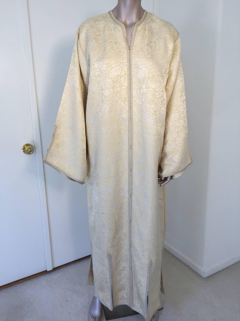 Moroccan caftan, Evening or interior gold and silver brocade dress kaftan with fine trim. Hand-made ceremonial caftan from North Africa, Morocco. Vintage exotic 1970s gold and silver brocade caftan gown. The luminous caftan maxi dress caftan is