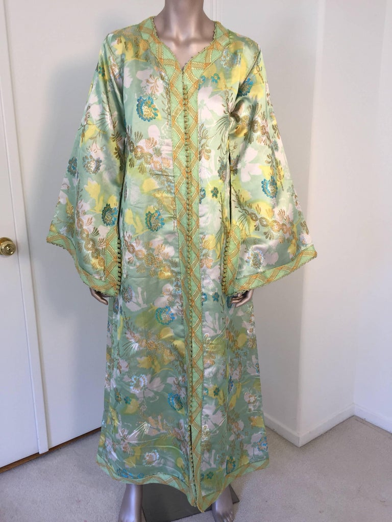 Moroccan caftan, evening or interior green and gold metallic floral brocade dress kaftan with gold and green trim. Handmade vintage exotic 1970s metallic green floral brocade caftan gown, ceremonial caftan from North Africa, Morocco. The luminous