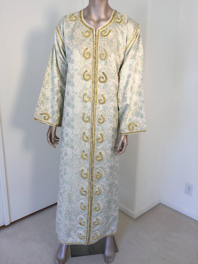 Elegant vintage designer Moroccan white brocade kaftan, embroidered with Turkish gold threads design.  This chic Gypsy Bohemian white, gold and light turquoise blue floral brocade maxi dress kaftan is embroidered and embellished with gold thread