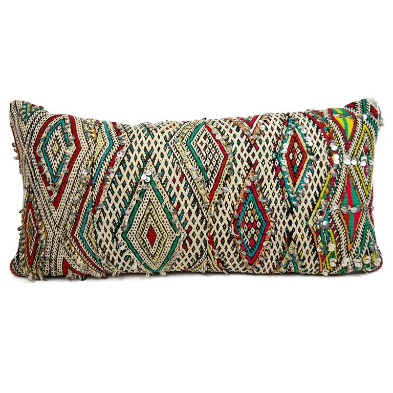 A stunning extra large bohemian Moroccan kilim cushion custom made in Morocco. Cut from a circa 40 years old hand loomed kilim rug, from the Middle Atlas Mountains. We have searched and selected the rug ourselves. The pillow has beautiful colors
