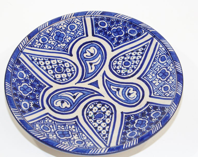 Moroccan handcrafted ceramic plate hand painted in blue and white geometric Moorish designs from Fez Morocco. Could be use as a wall hanging ceramic decorative plate or used to display fruits. Size: 10