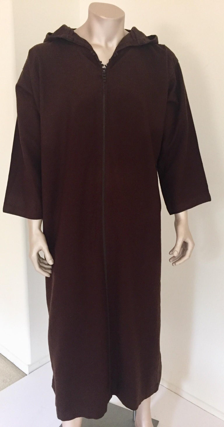 Moroccan traditional gentleman handcrafted hooded wool cashmere djellaba. Moroccan traditional ethnic gentleman kaftan coat in dark chocolate brown wool. This North African long hooded kaftan coat features a traditional form with side slits and long