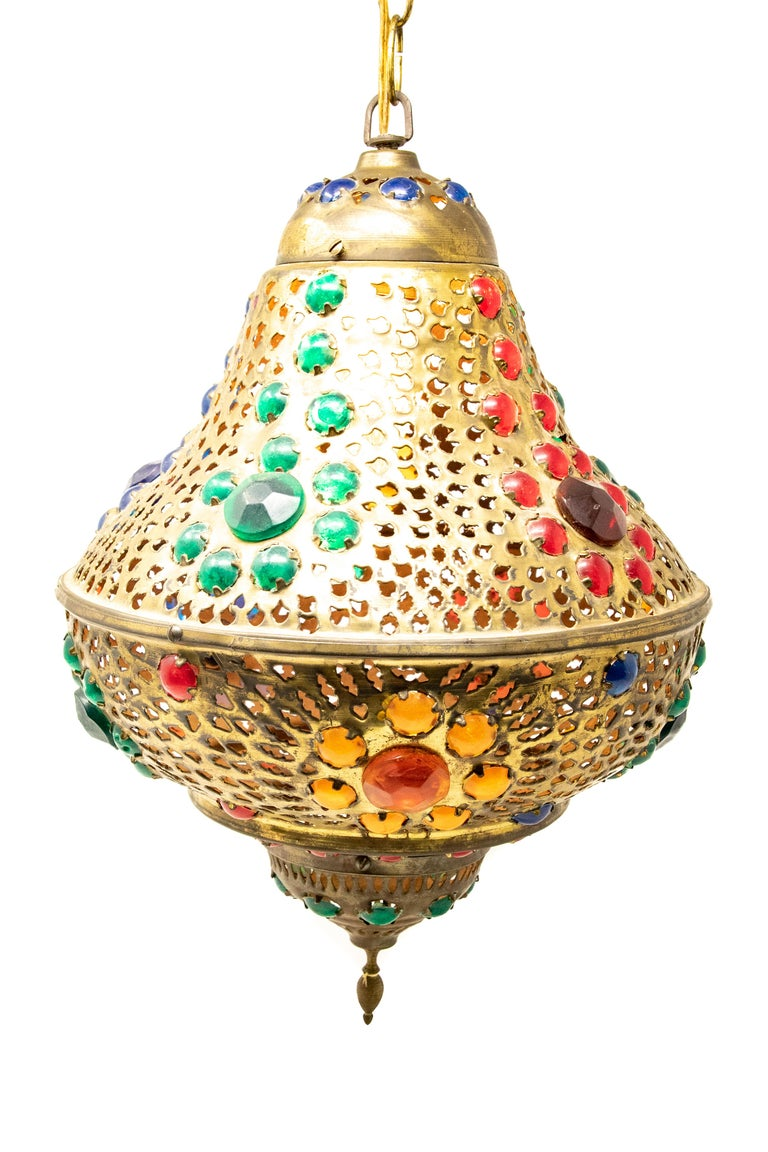 Offering this stunning Moroccan hanging lamp. Made of solid brass with jewel toned faceted cut stones. It is wired and does work.