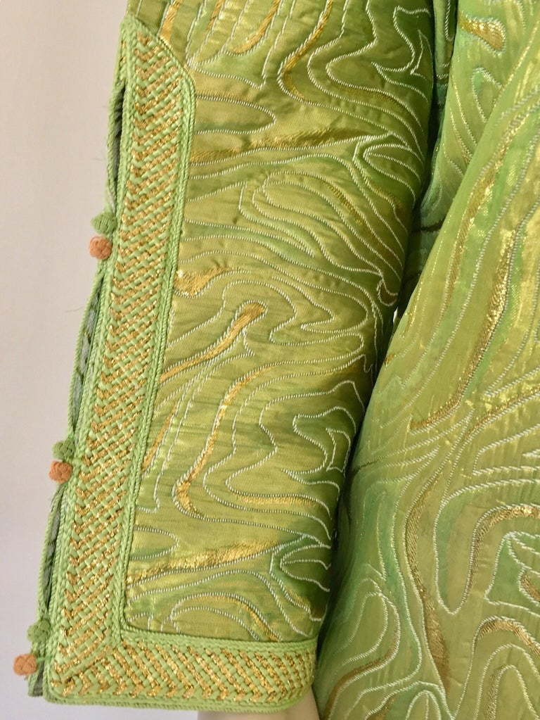 Elegant Moroccan caftan in green and gold lame metallic and embroidered trim, circa 1970s. This long maxi dress kaftan is embroidered and embellished entirely by hand. It's crafted in Morocco and tailored for a relaxed fit. One of a kind evening