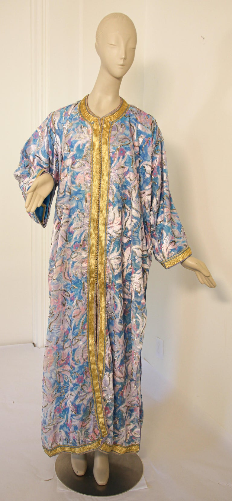 Elegant Moroccan caftan in turquoise and gold floral lame metallic and embroidered trim, circa 1970s. This long maxi dress kaftan is embroidered and embellished entirely by hand. It's crafted in Morocco and tailored for a relaxed fit. One of a