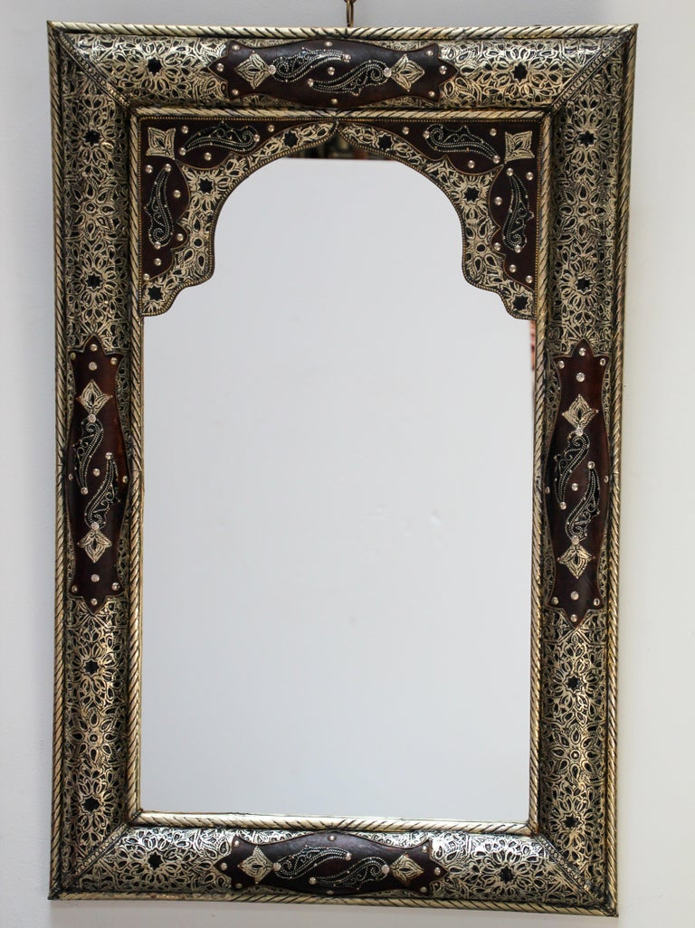Moroccan mirror decorated with silvered hammered and repousse metal delicately engraved and wrapped with leather.