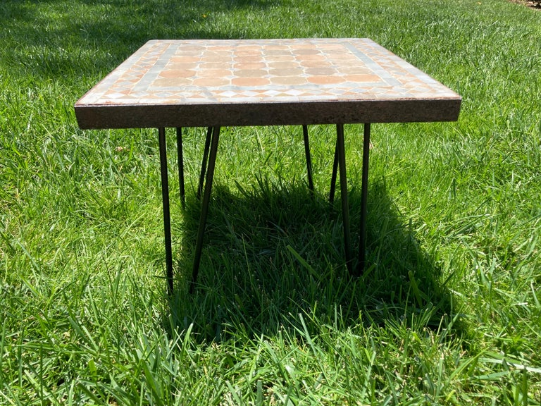 Moroccan mosaic tile square table on iron base.  Handmade by expert artisans in Fez, Morocco using reclaimed old glazed ivory and tan tiles inlaid in concrete using reclaimed old glazed tiles and making beautiful geometrical designs, the iron base