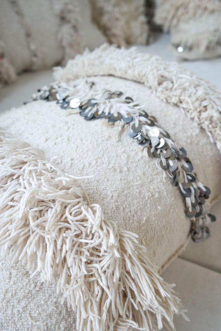 Gorgeous Moroccan wedding blanket pillow cover, refashioned from, by an El Ramla Hamra selected vintage wedding blanket  The story behind the Moroccan wedding blanket also called ''handira'' is beautiful. According to old Moroccan Berber tradition