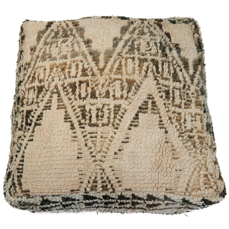 Make your space completely unique with this gorgeous pouf, custom made from a beautiful authentic circa 40 years old Beni Ourain rug. Adding a cozy and sophisticated touch to your space will be easy with this one-of-a-kind pouf. It is perfect for