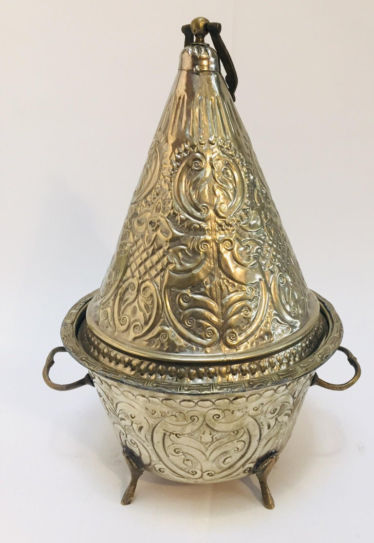 Gorgeous hand chased silver plated large Moroccan tajine dish with cover, typically used for presenting cookies or bread. Hand chased etching and embossed motifs with metal silver finish serving dish vessel. Very nice handcrafted large serving