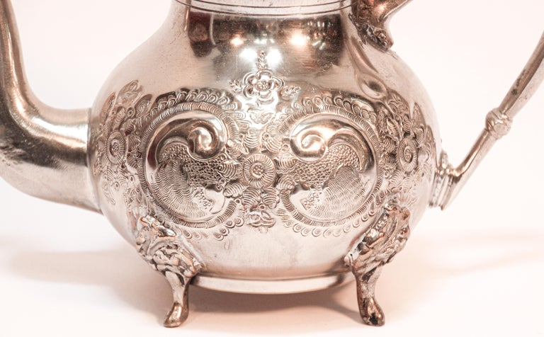 Traditional vintage silver plated and brass Moroccan tea pot, embossed with traditional repousse design, nicely aged, handcrafted in Fez, stamped in bottom. Great silver plated and brass decorative Islamic art object. Will make a great gift.