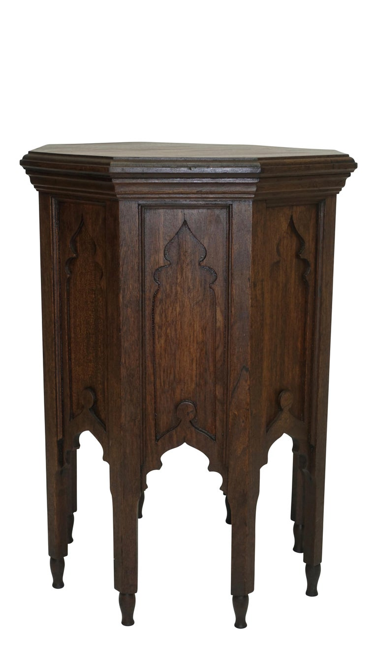 A hexagonal shape Moroccan taboret table with carved recessed panels standing on turned feet, early 20th century.
