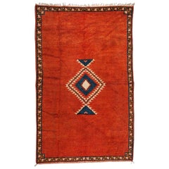 Moroccan Tribal Handwoven Rug or Carpet Wool with Blue Diamond on Red Background