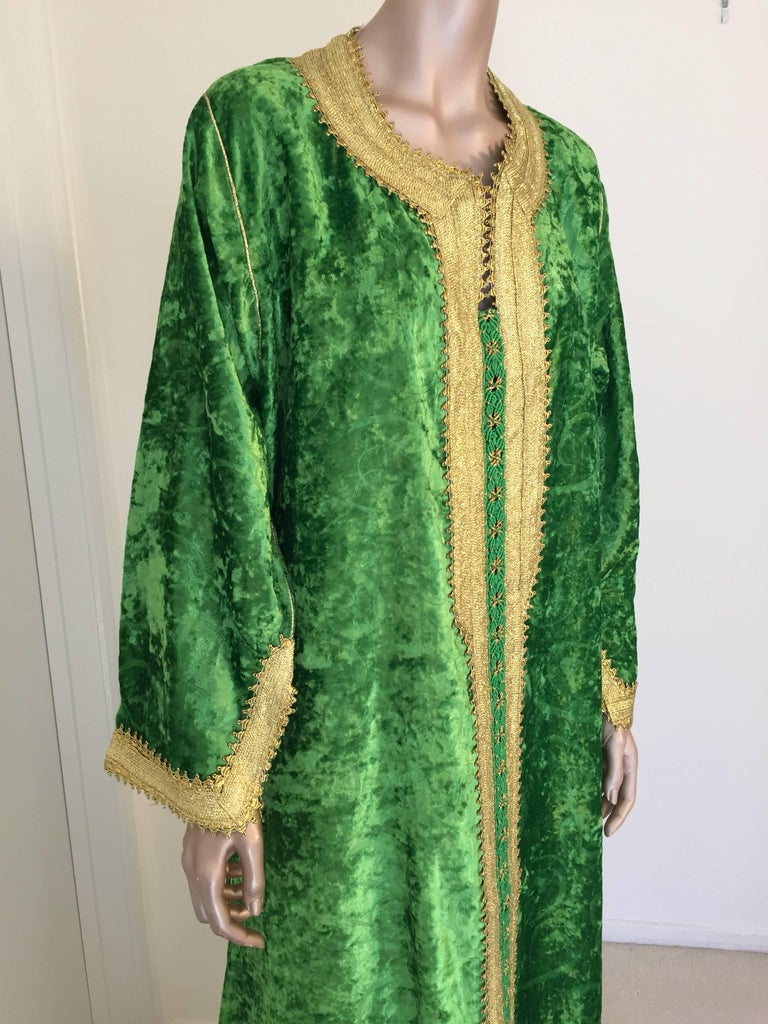 Gorgeous vintage designer Moroccan kaftan, Jade green velvet embroidered with a gold trim. This chic Gypsy Bohemian maxi dress caftan is embroidered and embellished with a gold thread metallic trim. One of a kind designer evening Moroccan Middle