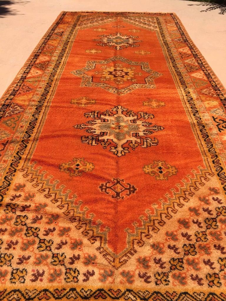Moroccan vintage orange color tribal African pile rug. Wonderful work of art, bright oranges geometrical design, free style, amazing vintage Moroccan runner. Handwoven by the Berber women in Morocco, organic lamb wool in vegetable